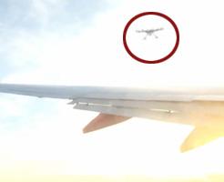 ドローンの神風アタックを受けた飛行機!乗客が機内から撮影!
